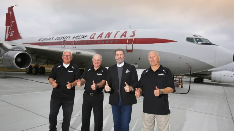 John Travolta officially hands over his Boeing 707 to HARS members Peter Elliott (left), John Dennis and Frank Bowden at Brunswick's Golden Isles Airport in Georgia USA on Sunday.
