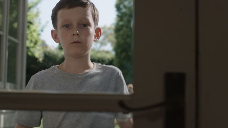 The ad campaign features a one-minute TV ad in which a young boy slams a door on a young girl, causing her to fall.