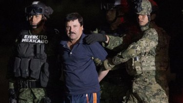 Mexican drug lord Joaquin 'El Chapo' Guzman is escorted by soldiers after being recaptured.