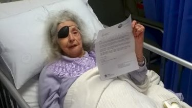 Elizabeth Rogers holds the eviction notice she was given at the Prince of Wales Hospital.