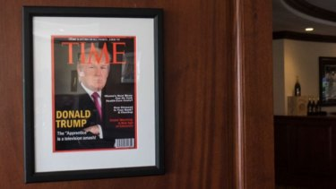 A fake edition of Time Magazine with Donald Trump on the cover hangs in a number of Trump properties.