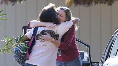 Two women embrace outside Rancho Tehama Elementary School, where a gunman opened fire on Tuesday.