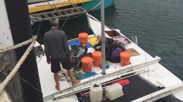 Alan Langdon on the deck of his catamaran in Ulladulla Harbour.