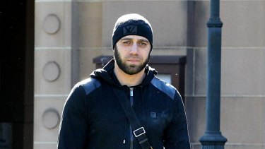 Victim Alex Ali leaves the NSW Supreme Court after giving evidence about his shooting in October, 2014.