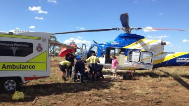 The Surat Gas Aero-Medical Service helicopter transports a 53-year-old man from a property near Roma.