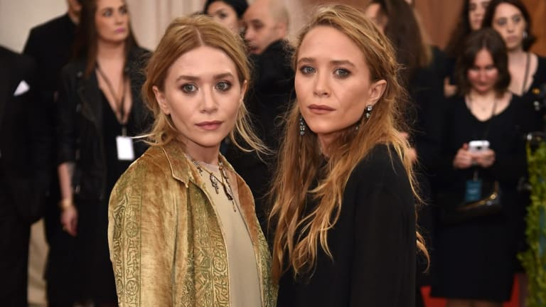 Ashley Olsen (left) and Mary-Kate Olsen, at last year's Costume Institute Gala, have become two of America's most sought-after designers.