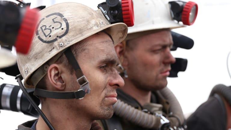 Rescuers listen to instruction in Vorkuta, Russia.