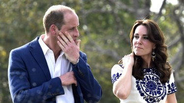 Prince William was spotted wiping his eyes after taking photographs with wife Catherine sitting on the same marble bench as Diana 24 years before.