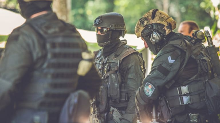 Police sent in a Special Emergency Response Team (pictured in a training exercise above) after the fatal shooting west of Brisbane.