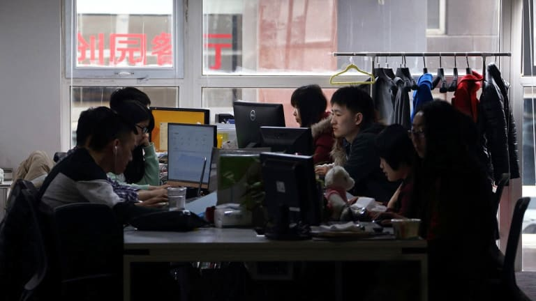 Workers use computers at their desks inside Tech Temple, a co-working space for start-up companies, in Beijing.