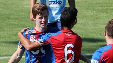 Young talent time: Braedyn Crowley celebrates scoring a goal for the Emerging Jets last season.