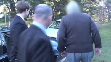 Paedophile priest Robert Flaherty being arrested at his Wentworth Falls home.