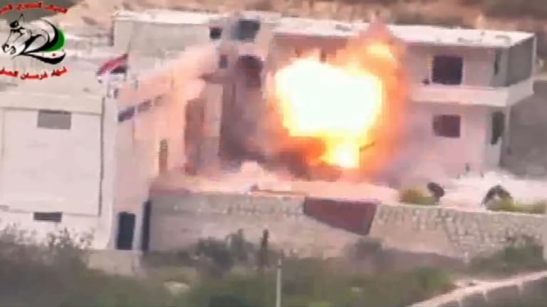 Footage supplied by the Free Syrian Army's Fursan al-Haq Brigade shows the moment of a US-supplied TOW missile's impact.
