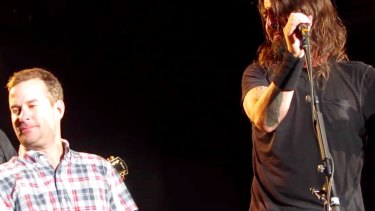 'Anthony the crying fan' is overcome and has to look away while on stage with Dave Grohl and the Foo Fighters in Colorado this week.