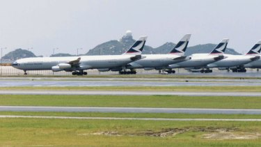Passengers have told of sparks and flames coming from the engine of the Cathay Pacific flight.