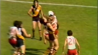 Bulldogs hard nut Basil Campbell cleans up Barry Beecroft at the start of the 1981 WAFL Grand Final.