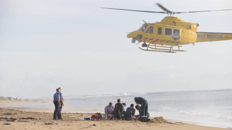 Paramedics worked to save Ben Gerring but he died in hospital several days after he was attacked by a shark.