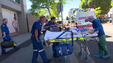 Paramedics take Amy Rickuss from The Cosmetic Institute to Westmead Hospital in January.