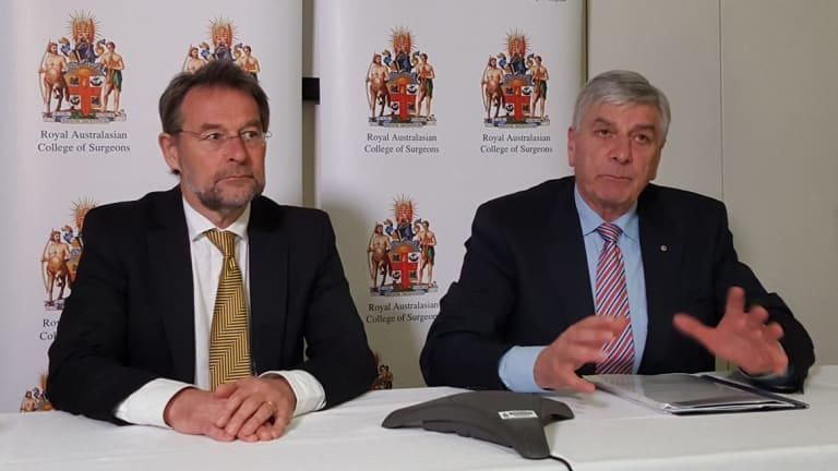 Royal Australasian College of Surgeons president David Watters (lelft) and Rob Knowles, chairman of the college's expert advisory group on bullying.