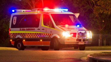 Paramedics stopped to move a woman off the road when they were hit with a pork chop in Darwin.