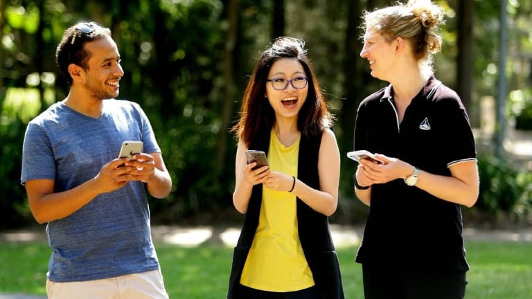 Students Ahmed Alqorashi, Shan Cai and Arlen East at the University of Newcastle, where staff have been warned about using phones while walking.