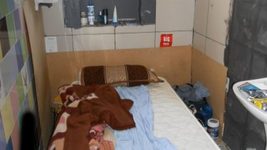 A bed in a bathroom of an illegal accommodation in the Sydney CBD.