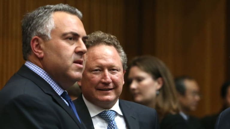 Beg to differ: Federal Treasurer Joe Hockey, left,  and mining magnate Andrew Forrest.