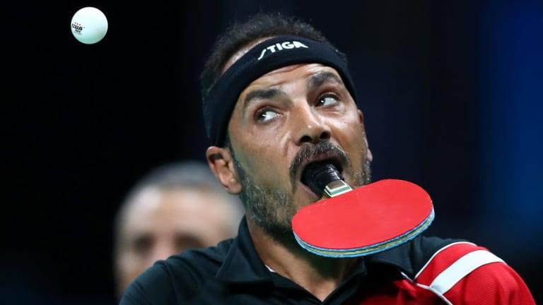 Ibrahim Hamadtou serves.in the men's singles at Rio.