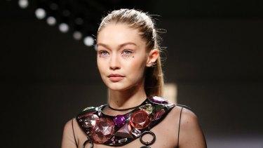 Like a rhinestone cowgirl ... Gigi Hadid modelling for Jeremy Scott at New York Fashion Week.