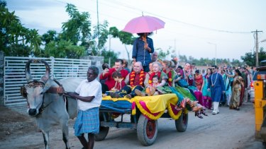 When getting married in India, Dom chooses to travel exclusively by bullock.