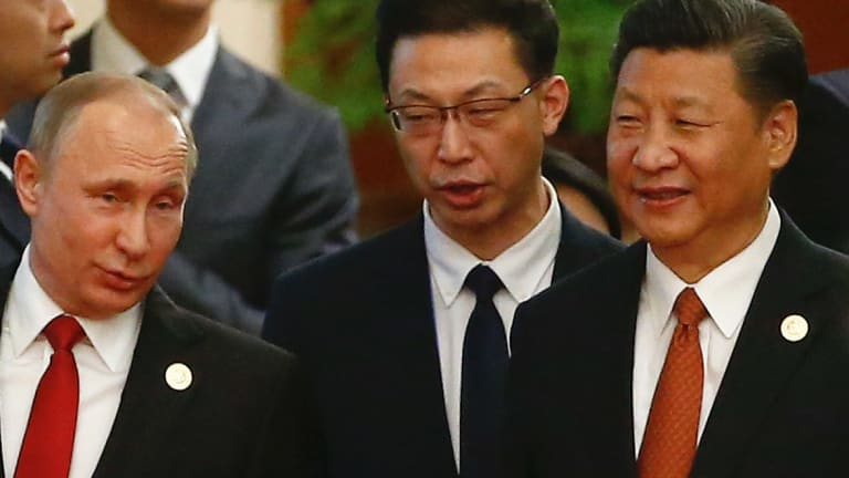 Chinese President Xi Jinping, right, and Russian President Vladimir Putin, left, arrive for the welcoming banquet for the Belt and Road Forum at the Great Hall of the People in Beijing.