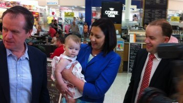 Opposition Leader Annastacia Palaszczuk, with federal counterpart Bill Shorten and Stretton candidate Duncan Pegg, delivers the first official baby cuddle of the Labor campaign to 12-month-old Larissa Soter of Sunnybank Hills.