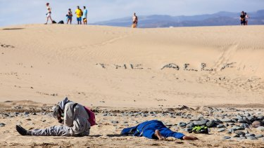 Two would-be immigrants rest at Maspalomas beach on Spain's Canary Islands.