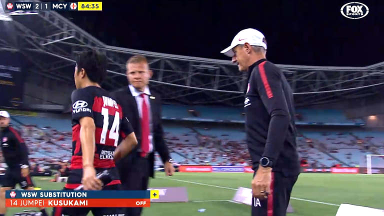 Unhappy: Jumpei Kusukami snubs Josep Gombau's handshake offer during the Wanderers victory over Melbourne City