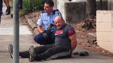 An unidentified man was handcuffed following the fatal shooting at Bankstown Central Shopping Centre, but was later released.