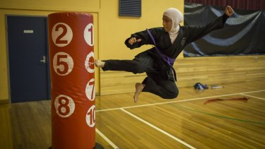 One of Ashleigh's photos to be exhibited as part of Seeing Summer: 17-year-old Saleha Amin from South Granville High taking part in a tae kwon do practice run by Master Ridvan in Auburn.