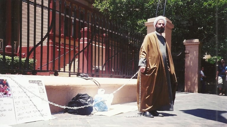 Man Haron Monis chained to the fence at Parliament House in 2001.