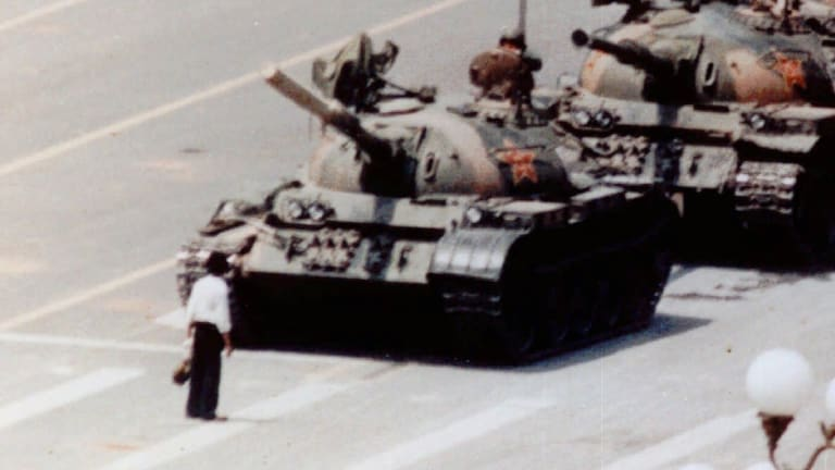 An anti-government protester stands in front of artillery tanks in Beijing's Tiananmen Square in 1989. The spirit of protest has died in Chinese students.