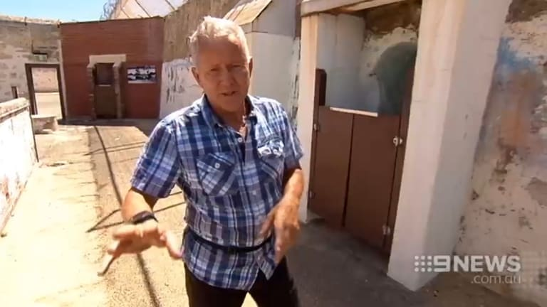 Ray Mickelberg at Fremantle Prison, describing the area where his finger was bitten off completely.