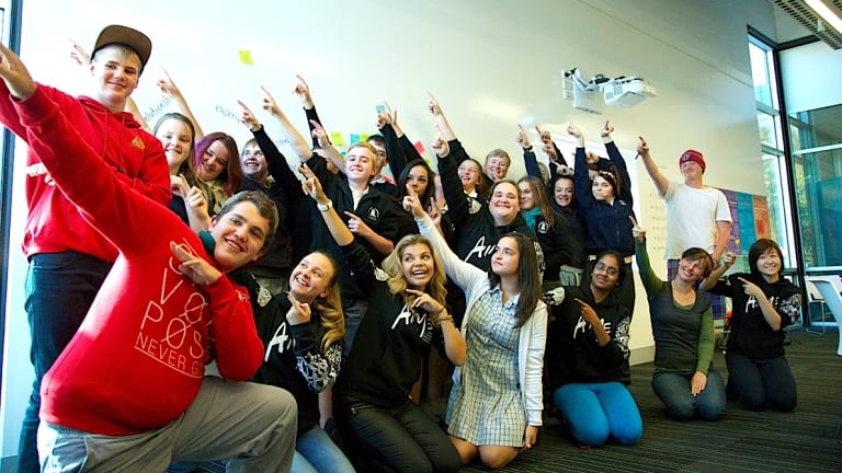 Making a difference: Australian Indigenous Mentoring Experience mentors with students in Canberra.