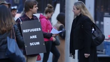 The 'Refugees are scum' sign was not well received by the public in Sydney's central business district.