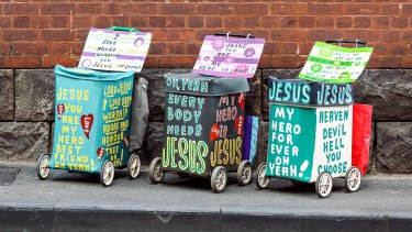It's art, Lord: Trolleys handpainted by street preacher Desmond Hynes feature in the Jesus Trolley exhibition.