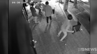 CCTV footage shows chairs being thrown.