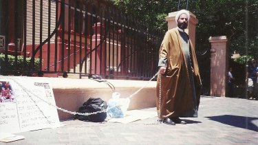 Early cause: Man Monis chained himself to the fence outside NSW Parliament House in 2001.