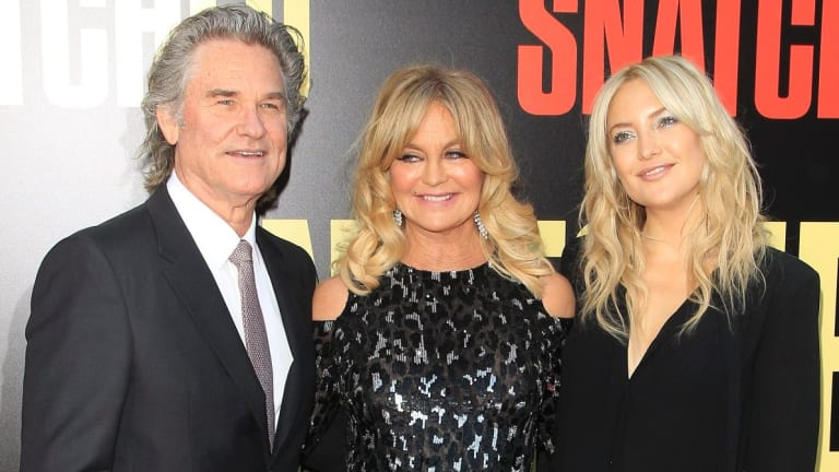 Kate Hudson with her step-father Kurt Russell and mother Goldie Hawn.