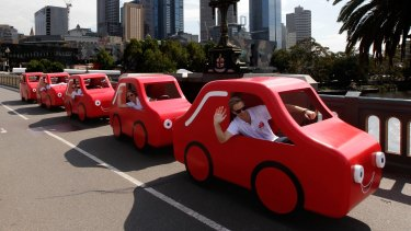 """Coles' """"little red cars"""" have become the symbol of its insurance business."""