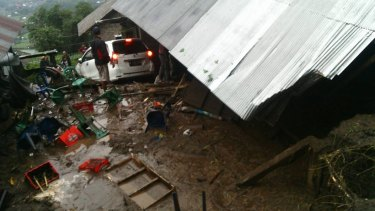 The landslide flattened homes in Bali.