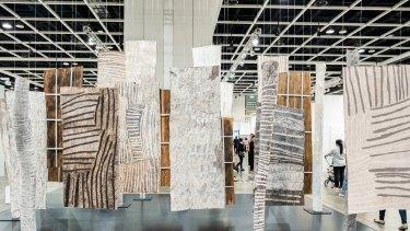 Sydney's Roslyn Oxley9 gallery presented forest of poles from Yirrkala artist Nyapanyapa Yunupingu.