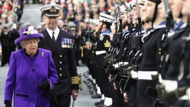 Britain's Queen Elizabeth II attends the commissioning ceremony for HMS Queen Elizabeth at HM Naval Base on Portsmouth on December 7.