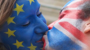 A perfect match? Young people at the Brandenburg Gate in Berlin show their support for the UK to remain in the EU.
